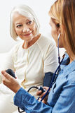 Blood pressure monitoring at home Stock Photo