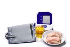 Blood pressure monitors with animal fat. High-volume cooking oil causes high blood pressure. Healthcare concept royalty free stock photography