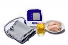Blood pressure monitors with animal fat. High-volume cooking oil causes high blood pressure. Healthcare concept royalty free stock images