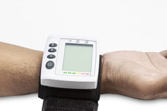 Blood pressure on patient wrist Royalty Free Stock Image