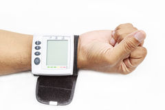 Blood pressure on patient wrist Stock Image
