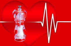 Blood Pressure. Salt Mill on Heart Background - Excess salt causes high blood pressure Royalty Free Stock Photos
