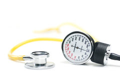 Blood pressure sphygmomanometer stethoscope. A sphygmomanometer and stethoscope on white. healthcare concept. Shallow DOF Royalty Free Stock Photography