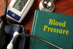 Blood Pressure. Title in a book and stethoscope royalty free stock image