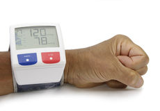 Blood presure monitor. Blood pressure monitor atached at wrist Royalty Free Stock Image