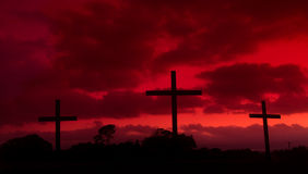 Blood Red Crosses. Three crosses with a blood red looking sky behind them Stock Photos