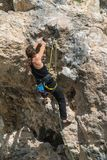 Female rock climber on a cliff royalty free stock images