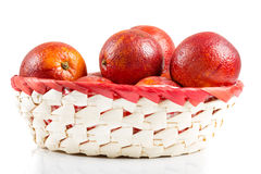Blood-red oranges in basket Royalty Free Stock Photos