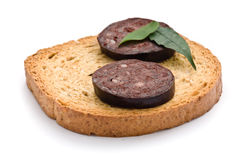 Blood sausage. Cut into slices on a white background Stock Images