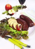 Blood sausage, apples, and glass of red wine Royalty Free Stock Images