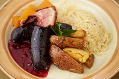 Blood sausage. With fried bacon and sauerkraut Royalty Free Stock Images