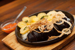 Blood sausage with potatoes Royalty Free Stock Image