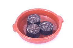 Blood sausage ( spanish ). Fried blood sausage with rice, morcilla royalty free stock photo