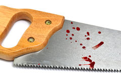 Blood and saw. Hand saw with blood spill, accident at work stock images