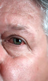 Blood shot eye. A blood shot eye of a mature man stock images