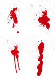 Blood Spatter III. A composite of 4 wet red paint (blood) stains isolated on white Royalty Free Stock Image