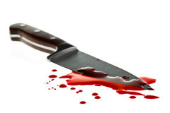 Blood splatter. Red blood splatter with  kitchen knife, shallow DOF Stock Photo