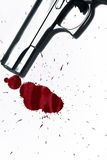 Blood splatter and Gun. Illustrative shot of a hand gun and blood splatter. Murder / Homicide Scene royalty free stock photo