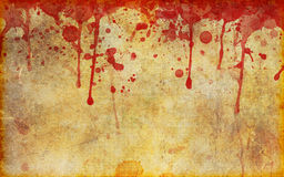 Blood Splattered Old Stained Parchment. An old, stained, aged and damaged page of parchment with dripping and splattered blood stains across the top Stock Image