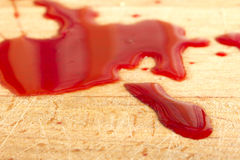 Blood splattered on a wooden surface Stock Photo