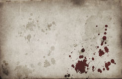 Blood spots on grunge paper Stock Photos