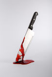 Blood stained kitchen knife. Stuck in surface Royalty Free Stock Photography