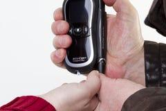 Blood sugar measuring device Stock Photos