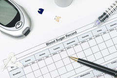 Blood Sugar Record. With insulin pen, glucometer, and lancets Royalty Free Stock Image