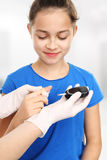 Blood sugar testing, child finger lancet punctures Royalty Free Stock Photos