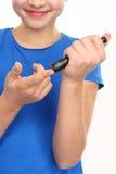 Blood sugar testing, child finger lancet punctures Royalty Free Stock Images