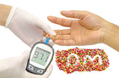 Blood sugar value is measured on a finger by female doctor in white medical gloves and decorative sprinkles sugar in alphabet shap Stock Photos