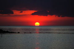Blood sun and sky. A sunset time have a blood color of the sun and sky at the sea Royalty Free Stock Image