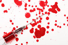 Blood with syringe Stock Photography
