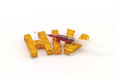 Blood in  syringe and  needle on A word  HIV  background Royalty Free Stock Image