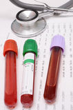 Blood test tube and stethoscope Royalty Free Stock Photo