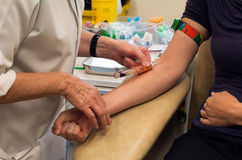 Blood Test. Young woman having blood test in a clinic royalty free stock images