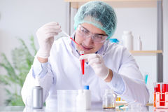 The blood testing in the lab with young scientist Royalty Free Stock Photos