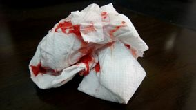 Blood on tissue paper. Easy to stop bleeding but not hygienic clean stock photo