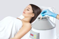 The blood tube is removed from the medical centrifuge for plasma lifting. Prp procedure stock image