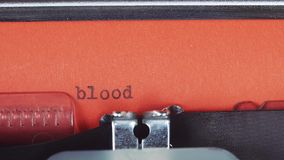 Blood - Typed on a old vintage typewriter. Printed on red paper. The red paper is inserted into the typewriter stock video