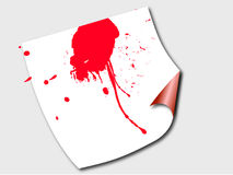Blood war. Blood on a paper lying on a floor Stock Image