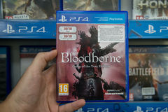 Bloodbourne. Bratislava, Slovakia, circa april 2017: Man holding Bloodbourne Game of the year edition videogame on Sony Playstation 4 console in store Stock Image