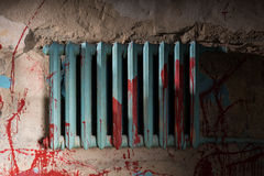 Bloodied battery in dimly lit basement Royalty Free Stock Photos