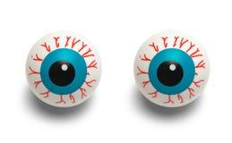 Bloodshot Eyes. Two Blood Shot Plastic Eyes Isolated on White Background royalty free stock photos