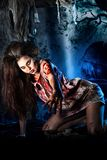 Bloodthirsty. Zombi standing at the night cemetery in the mist and moonlight Stock Images