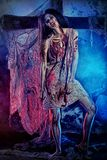 Bloodthirsty. Zombi standing at the night cemetery in the mist and moonlight Royalty Free Stock Images