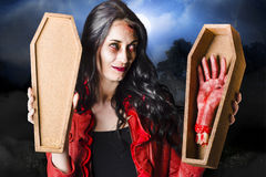 Female Halloween zombie holding undead hand Stock Photos