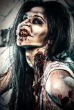 Bloody minded. Bloodthirsty zombi standing at the night cemetery in the mist and moonlight Royalty Free Stock Photo