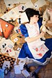 Bloody alice. Portrait of a young woman dressed as Alice in Wonderland, video game royalty free stock photography