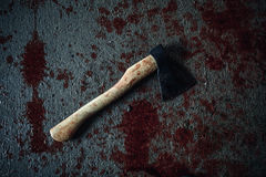 Bloody ax lying on the floor Stock Photos